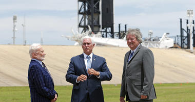 Apollo astronaut Buzz Aldrin, left, talks with Vice President Mike Pence, center, and Rick Armstrong, son of Apollo 11 astronaut Neil Armstrong