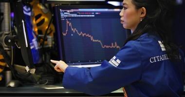 Specialist Lingbo Jiang works on the floor of the New York Stock Exchange