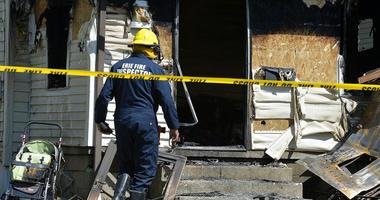 Erie Bureau of Fire Inspector Mark Polanski helps investigate a fatal fire at 1248 West 11th St. in Erie, Pa