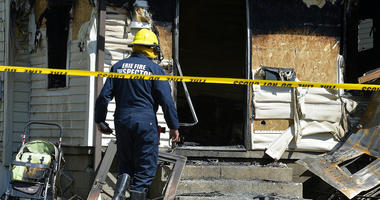 Erie Bureau of Fire Inspector Mark Polanski helps investigate a fatal fire at 1248 West 11th St. in Erie, Pa