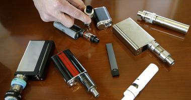 Marshfield High School Principal Robert Keuther displays vaping devices