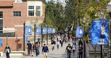 tudents walk on the University of California, Los Angeles campus.