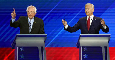 Sen. Bernie Sanders, I-Vt., left, and former Vice President Joe Biden speak during a Democratic presidential primary debate hosted by ABC at Texas Southern University in Houston.