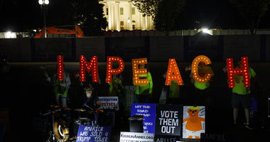 "Protesters with ""Kremlin Annex"" call to impeach President Donald Trump in Lafayette Square Park in front of the White House in Washington, Tuesday, Sept. 24, 2019."