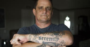 John Delaney shows off his tattoos