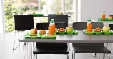 Trays with healthy food on table