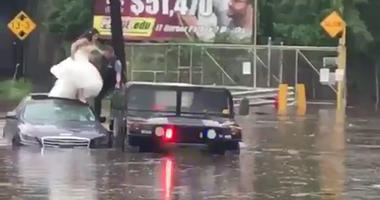Police Rescue Bride, Wedding Party Trapped In Car On Flooded Road