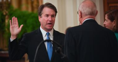 Newly confirmed Supreme Court Justice Brett Kavanaugh with retiring Supreme Court Justice Anthony Kennedy