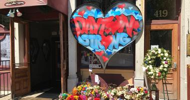 A memorial of flowers, cards, dolls and a Dayton Strong heart surround Ned Peppers outside the Aug. 4 mass shooting scene. Mass shooting memorial outside Ned Peppers