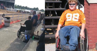 Watch Boy with Disability Hold Onto Wheelchair To Stand Up For National Anthem