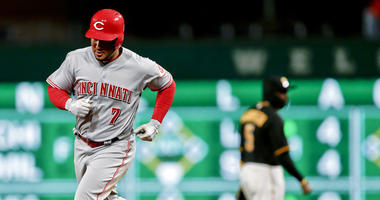 Cincinnati Reds' Eugenio Suarez, Pittsburgh Pirates' Josh Harrison