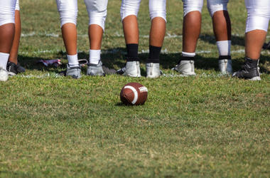 Football placed on field – Players getting ready for the game