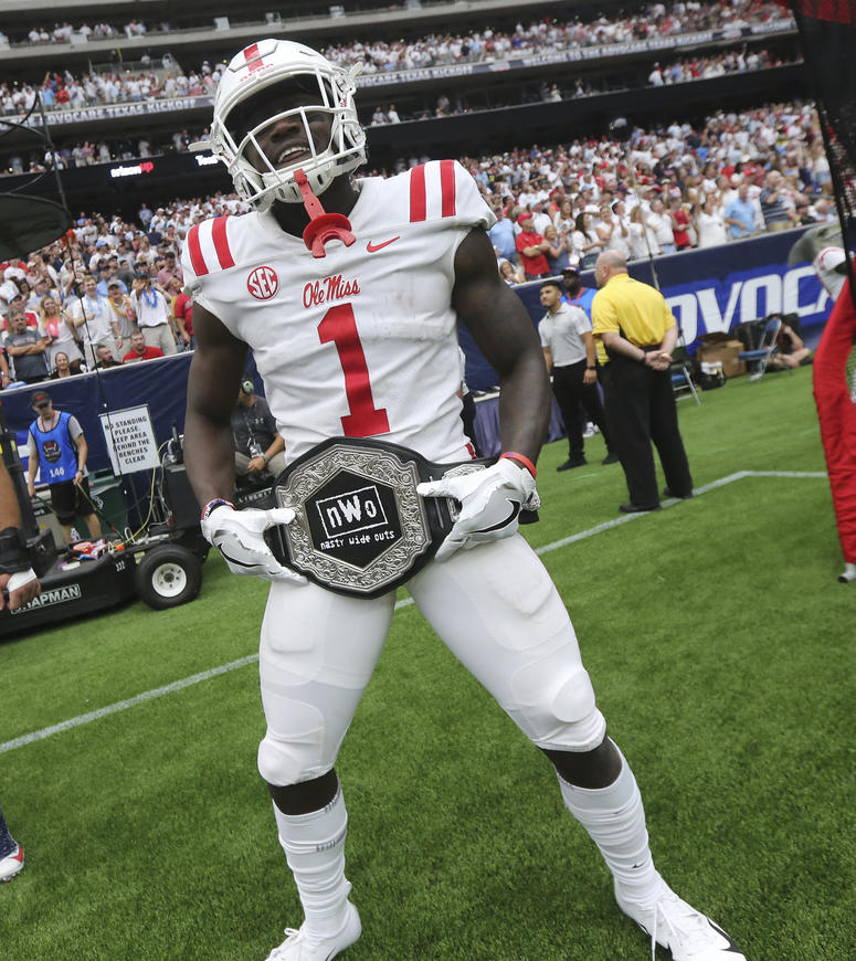 "Mississippi wide receiver A. J. Brown displays the team's ""Nasty Wide Outs"" belt"
