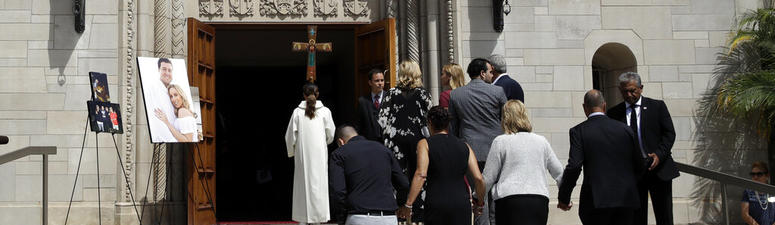 Members of Los Angeles Angels pitcher Tyler Skaggs' family hold hands as the walk into the St. Monica Catholic Church for a memorial service in his honor Monday, July 22, 2019, in Los Angeles.