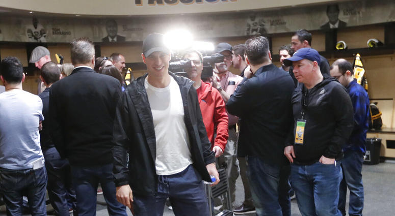 Pittsburgh Penguins' Sidney Crosby walks from reporters after talking with them in the practice facility locker room before leaving for the off season two days after being swept by the New York Islanders in the first round of the NHL hockey playoffs, Thur