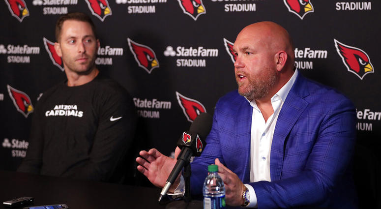 Arizona Cardinals head coach Kliff Kingsbury, left, and general manager Steve Keim discusses the upcoming NFL football draft during a news conference, Tuesday, April 16, 2019, in Tempe, Ariz.
