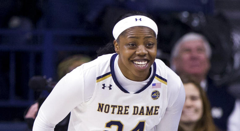 Notre Dame's Arike Ogunbowale runs downcourt after making a 3-pointer during an NCAA college basketball game against Duke in South Bend, Ind.