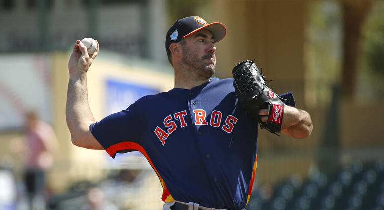 Houston Astros pitcher Justin Verlander throws during the first inning of a spring training baseball game against the Miami Marlins at the Roger Dean Chevrolet Stadium on Thursday, in Jupiter, Fla.