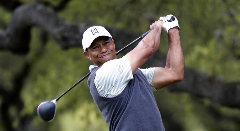 Tiger Woods watches his drive on the eighth hole during fourth round play at the Dell Technologies Match Play Championship golf tournament, Saturday, March 30, 2019, in Austin, Texas.