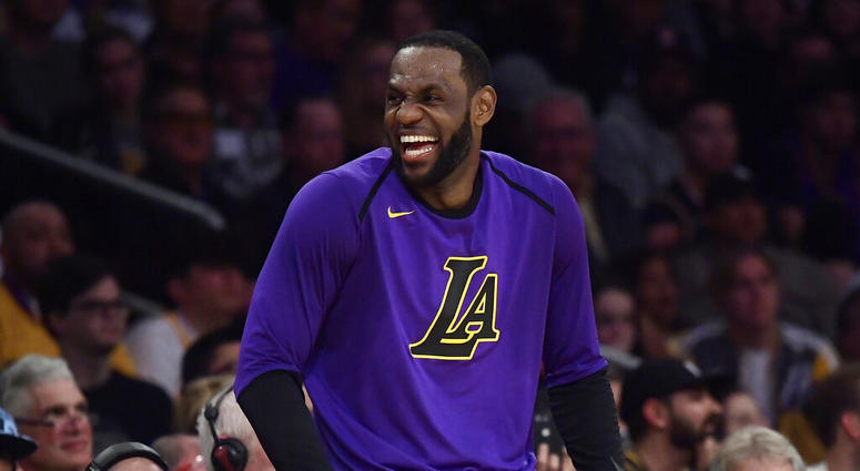 Los Angeles Lakers forward LeBron James laughs as he waits to check in to the team's NBA basketball game against the Charlotte Hornets during the second half Friday, March 29, 2019, in Los Angeles. The Lakers won 129-115.