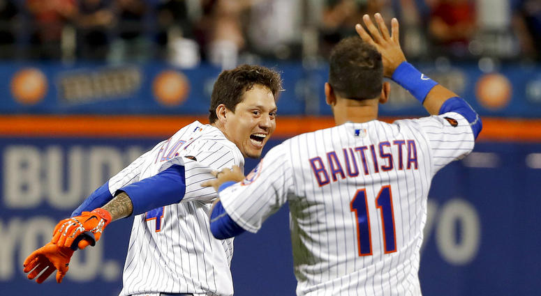 New York Mets' Wilmer Flores and Jose Bautista