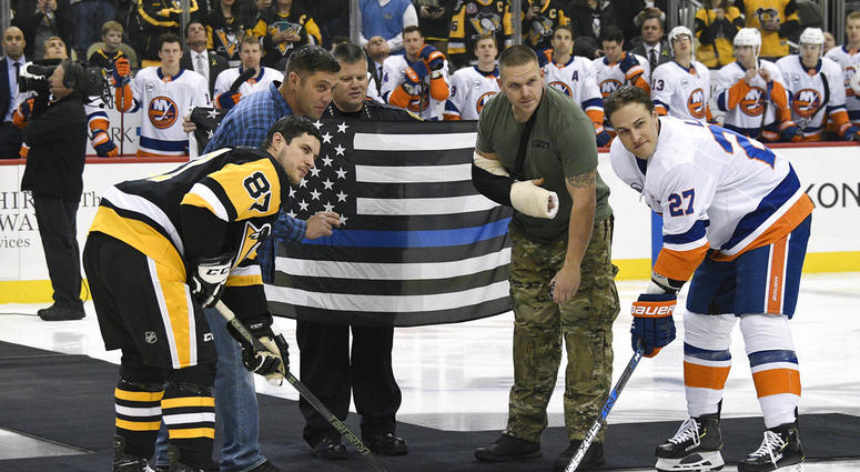 Pittsburgh Police Officer Mike Smidga, Pittsburgh Police Chief Scott Schubert and Officer Anthony Burke