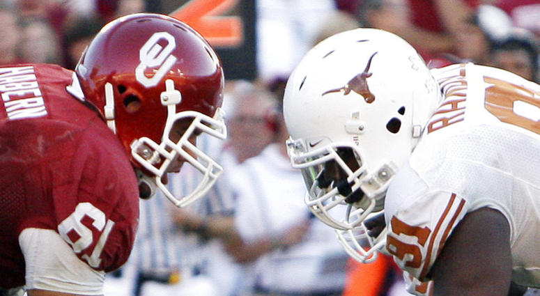 Texas defensive tackle Kheeston Randall (91) and Oklahoma offensive lineman Ben Habern (61) face off at the line of scrimmage