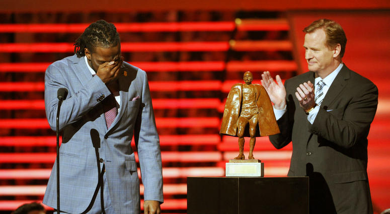 66e40f74cbc Charles Tillman of the Chicago Bears, left, accepts the award for Walter  Payton NFL