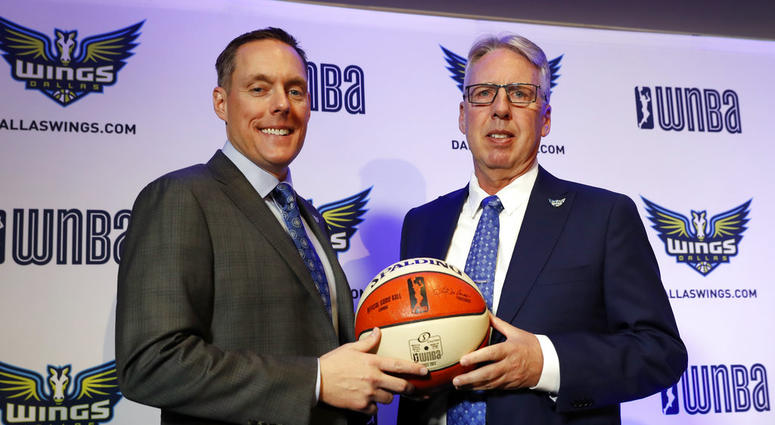 Dallas Wings President and CEO Greg Bibb, left, poses for a photo with newly hired head coach Brian Agler