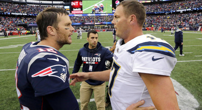 New England Patriots quarterback Tom Brady (12) and Los Angeles Chargers quarterback Philip Rivers