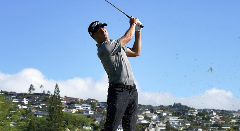 Justin Thomas hits from the 16th fairway during the second round of the Sony Open PGA Tour golf event, Friday, Jan. 11, 2019,