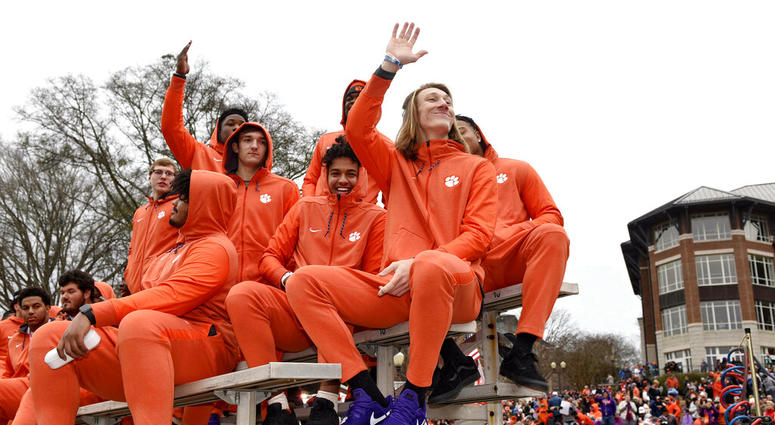 Clemson quarterback Trevor Lawrence, right, along with fellow freshman ride in the parade honoring Clemson Saturday, Jan. 12, 2019, in Clemson
