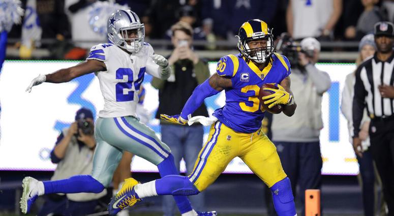 Los Angeles Rams running back Todd Gurley scores past Dallas Cowboys