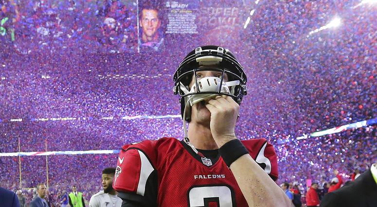 Atlanta Falcons quarterback Matt Ryan reacts after losing Super Bowl 51 as the screen flashes New England Patriots quarterback Tom Brady