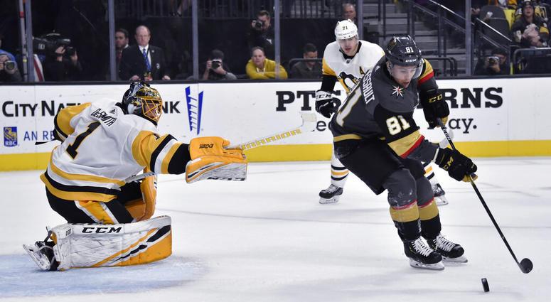 Vegas Golden Knights center Jonathan Marchessault (81) shoots against Pittsburgh Penguins goaltender Casey DeSmith (1