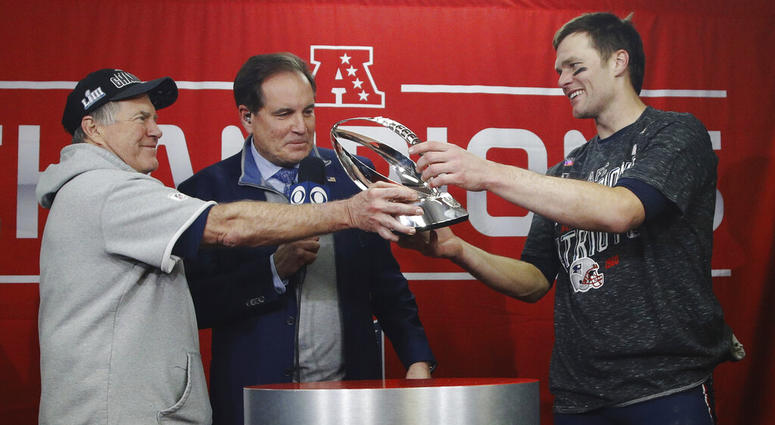 334859572 New England Patriots head coach Bill Belichick, left, hands off the  championship trophy to