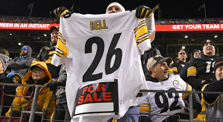 a Pittsburgh Steelers fan holds a Le'Veon Bell jersey