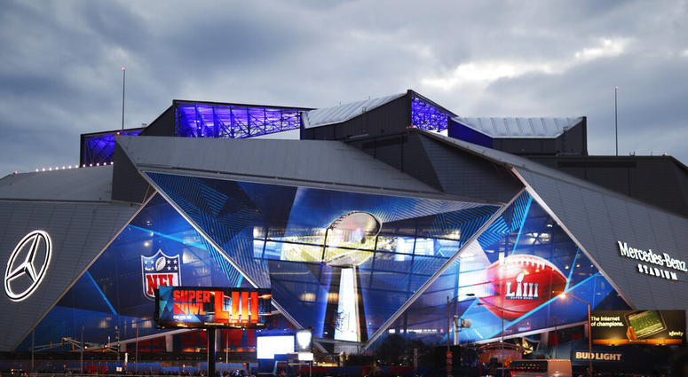 Mercedes-Benz Stadium is lit up ahead of Sunday's NFL Super Bowl 53 football game between the Los Angeles Rams and New England Patriots in Atlanta, Saturday, Feb. 2, 2019