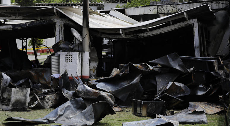 Debris from the deadly fire at the Flamengo soccer club training complex litters the ground in Rio de Janeiro, Brazil, Friday, Feb. 8, 2019