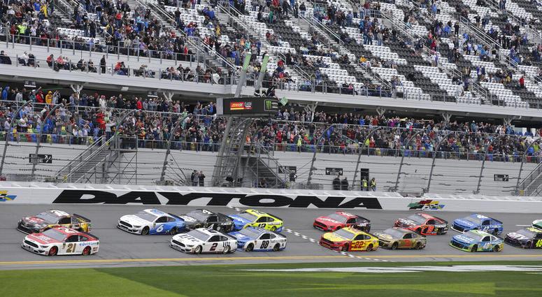 Paul Menard (21) and Kyle Busch, top left, lead the field of cars to start the NASCAR Clash auto race at Daytona International Speedway, Sunday, Feb. 10, 2019, in Daytona Beach, Fla.