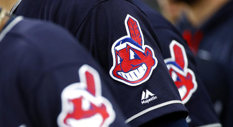 members of the Cleveland Indians wear uniforms featuring mascot Chief Wahoo