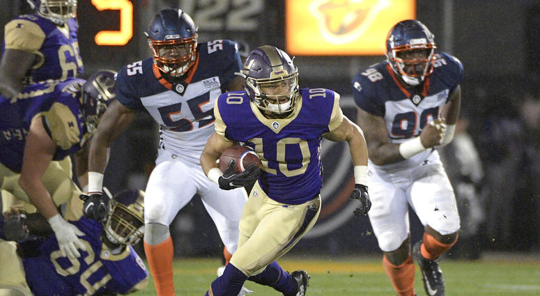 Atlanta Legends receiver Justin Thomas (10) runs with a reception in front of Orlando Apollos linebacker Andrew Ankrah (55) and defensive end Anthony Moten Jr. (98) during the second half of an Alliance of American Football game