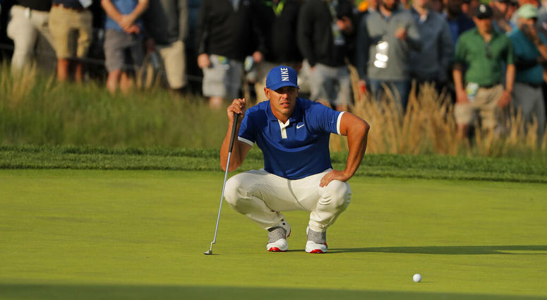 Brooks Koepka lines up a putt on the 17th green during the second round of the PGA Championship golf tournament, Friday, May 17, 2019, at Bethpage Black in Farmingdale, N.Y.