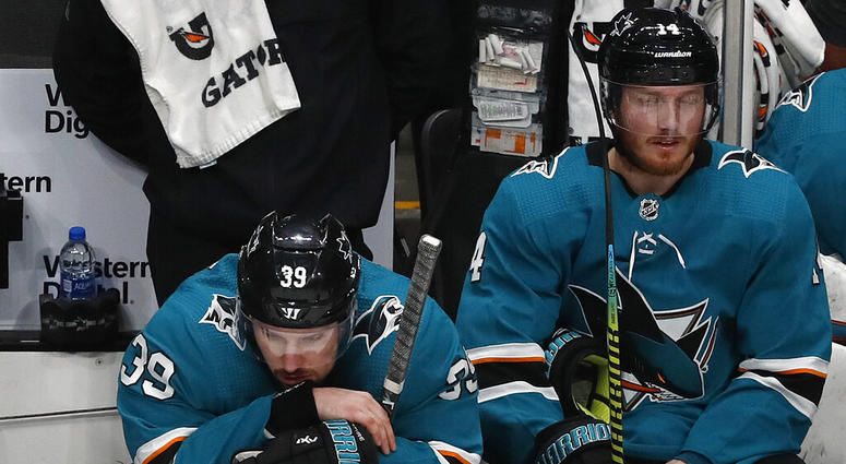 San Jose Sharks' Logan Couture (39) and Gustav Nyquist (14) react on the bench as the St. Louis Blues take a 5-0 lead in the third period in Game 5 of the NHL hockey Stanley Cup Western Conference finals in San Jose, Calif., on Sunday, May 19, 2019.