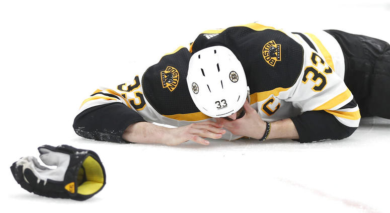 Boston Bruins defenseman Zdeno Chara, of Slovakia, lies on the ice after getting hit in the face with the puck during the second period of Game 4 of the NHL hockey Stanley Cup Final against the St. Louis Blues Monday, June 3, 2019, in St. Louis. (