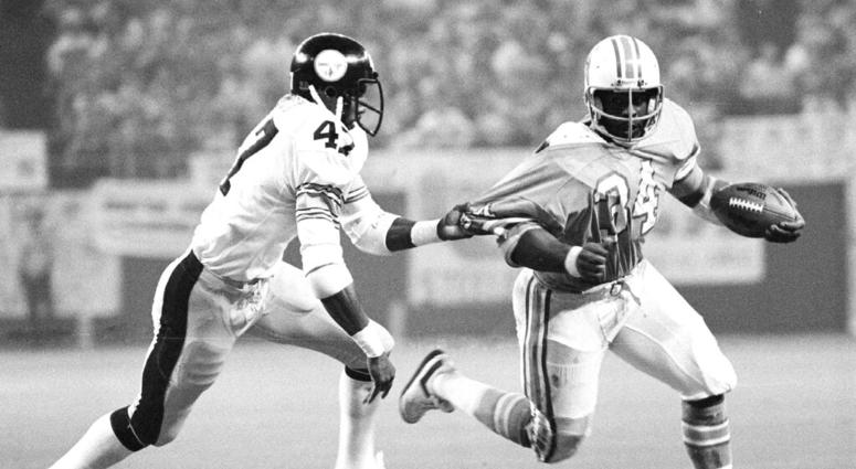 72342bb59c5 Pittsburgh Steelers' Mel Blount (47) grabs the jersey of Houston Oilers  running back