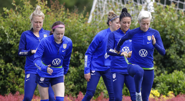 US player Megan Rapinoe, front right, stretches with Ali Krieger and other team members during a US womens soccer team training session at the Tottenham Hotspur training centre in London, Thursday, June 6, 2019. The Women's World Cup starts in France on J