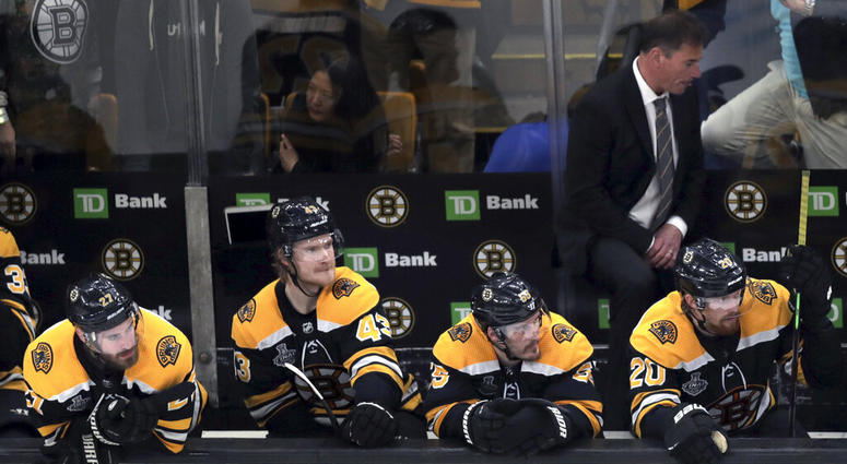 Boston Bruins players and head coach Bruce Cassidy, right rear, watch the final minutes in Game 5 of the NHL hockey Stanley Cup Final against the St. Louis Blues, Thursday, June 6, 2019, in Boston.