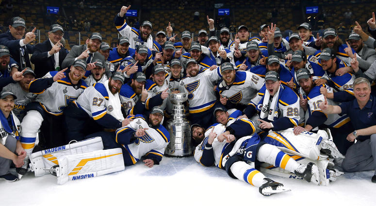3e9cb987855 The St. Louis Blues celebrate with the Stanley Cup after they defeated the  Boston Bruins