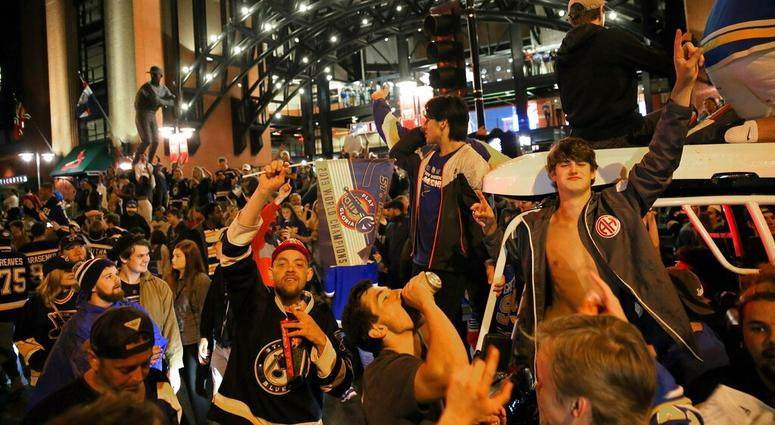 St. Louis Blues fans celebrate outside Busch Stadium in St. Louis, where a watch party had been held for Game 7 of the NHL hockey Stanley Cup Final between the Blues and the Boston Bruins in Boston, Wednesday, June 12, 2019. The Blues won the title.